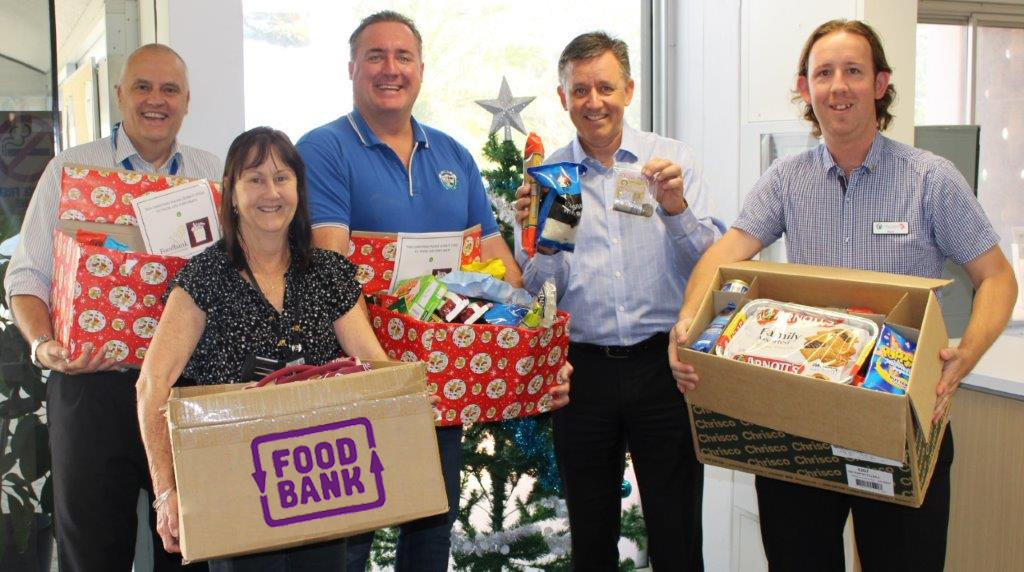 City staff help stock Foodbank shelves